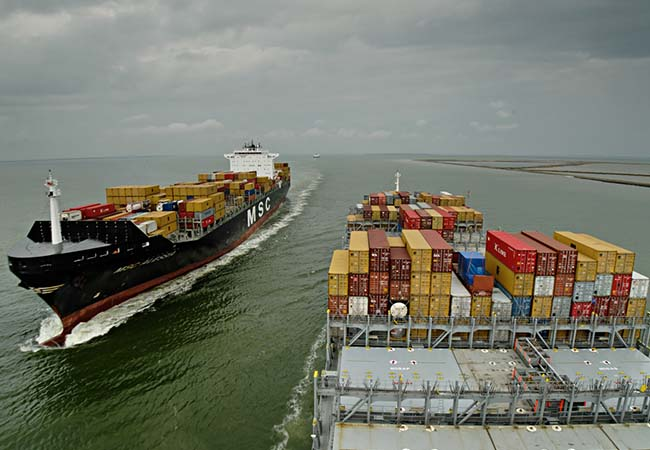 Stacked containers reduced the manpower necessary to move cargo off and on a ship.